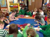 Student Council helping younger children making St Patrick's day cards
